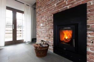 Benefits of Wood Stove Fireplace Inserts - Champs Chimney
